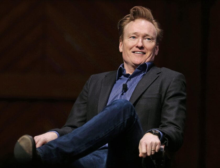 Television host Conan O'Brien smiles towards the audience at Sanders Theatre on the campus of Harvard University in Cambridge, Friday, Feb. 12, 2016.  O'Brien, who graduated from the school in 1985, shared a conversation with Harvard President Drew Faust and an audience of guests. (AP Photo/Charles
