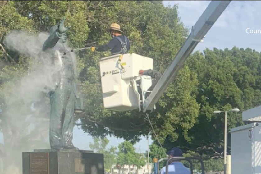 A statue of Martin Luther King Jr. is power washed after being vandalized.
