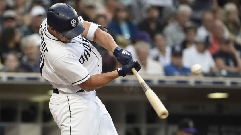 Hunter Renfroe hits a solo home run in the fourth inning Saturday against the Colorado Rockies at Petco Park.