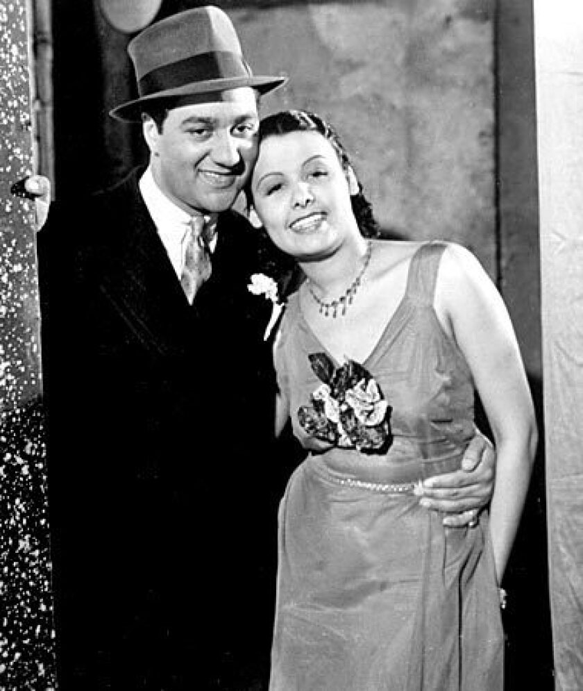 """Ralph Cooper and Horne in 1938's """"The Duke Is Tops."""" Horne's mother pushed her daughter to quit school at 16 and go into show business at Harlem's Cotton Club. Horne, who broke racial barriers as a Hollywood and Broadway star famed for her velvety rendition of """"Stormy Weather,"""" has died at 92."""