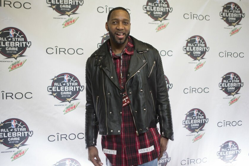 Retired NBA player Tracy McGrady arrives for the Celebrity Game, part of NBA basketball's All-Star weekend, in Toronto on Friday, Feb. 12, 2016. (Chris Young/The Canadian Press via AP)