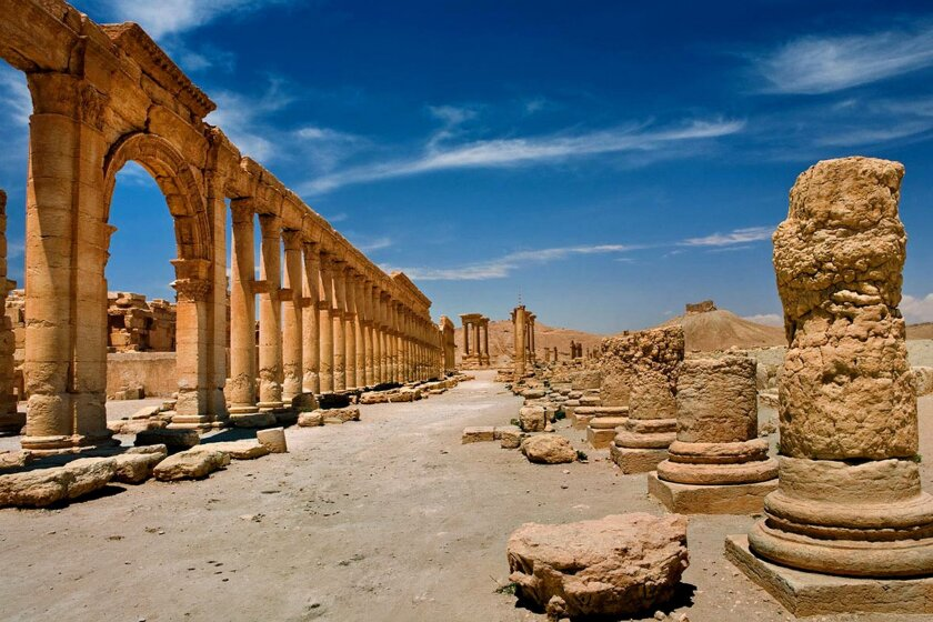In this undated photo released by the Syrian official news agency SANA, shows the site of the ancient city of Palmyra, Syria. Palmyra is an archaeological gem that Syrian troops took back from Islamic State fighters on Sunday, March 27, 2016. Syrian state media and an opposition monitoring group say government forces backed by Russian airstrikes have driven Islamic State fighters from the historic central town of Palmyra, held by the extremists since May. (SANA via AP)