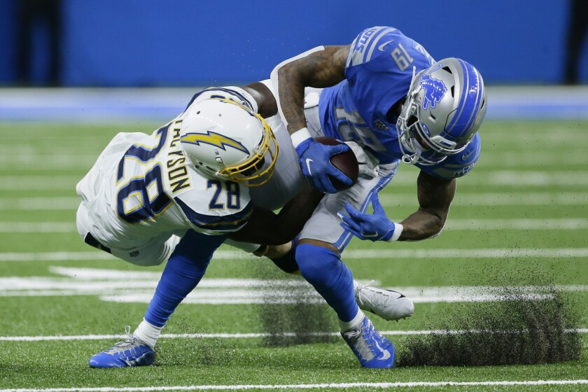 Chargers defensive back Brandon Facyson (28) brings Detroit Lions wide receiver Kenny Golladay  during their game in September.