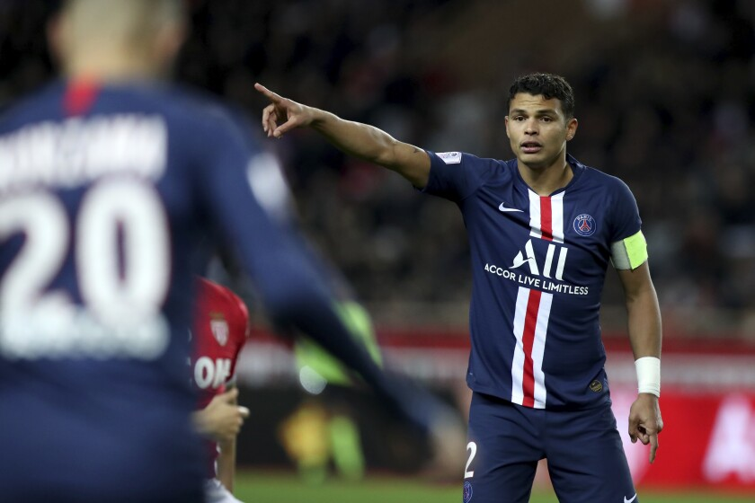 FILE - In this Wednesday, Jan. 15, 2019 file photo, PSG's Thiago Silva points during their French League One soccer match against Monaco at the Louis II stadium in Monaco. Thiago Silva's last competitive game was for Paris Saint-Germain in last month's Champions League final that the French club lost 1-0 to Bayern Munich. Contrast that occasion with his likely debut for Chelsea, a low-profile English League Cup match against second-tier Barnsley on Wednesday, Sept. 23, 2020. (AP Photo/Daniel Cole, file)