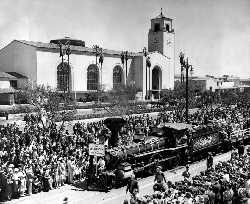 Crowds watch train celebrating completion of the new Union Station, 1939