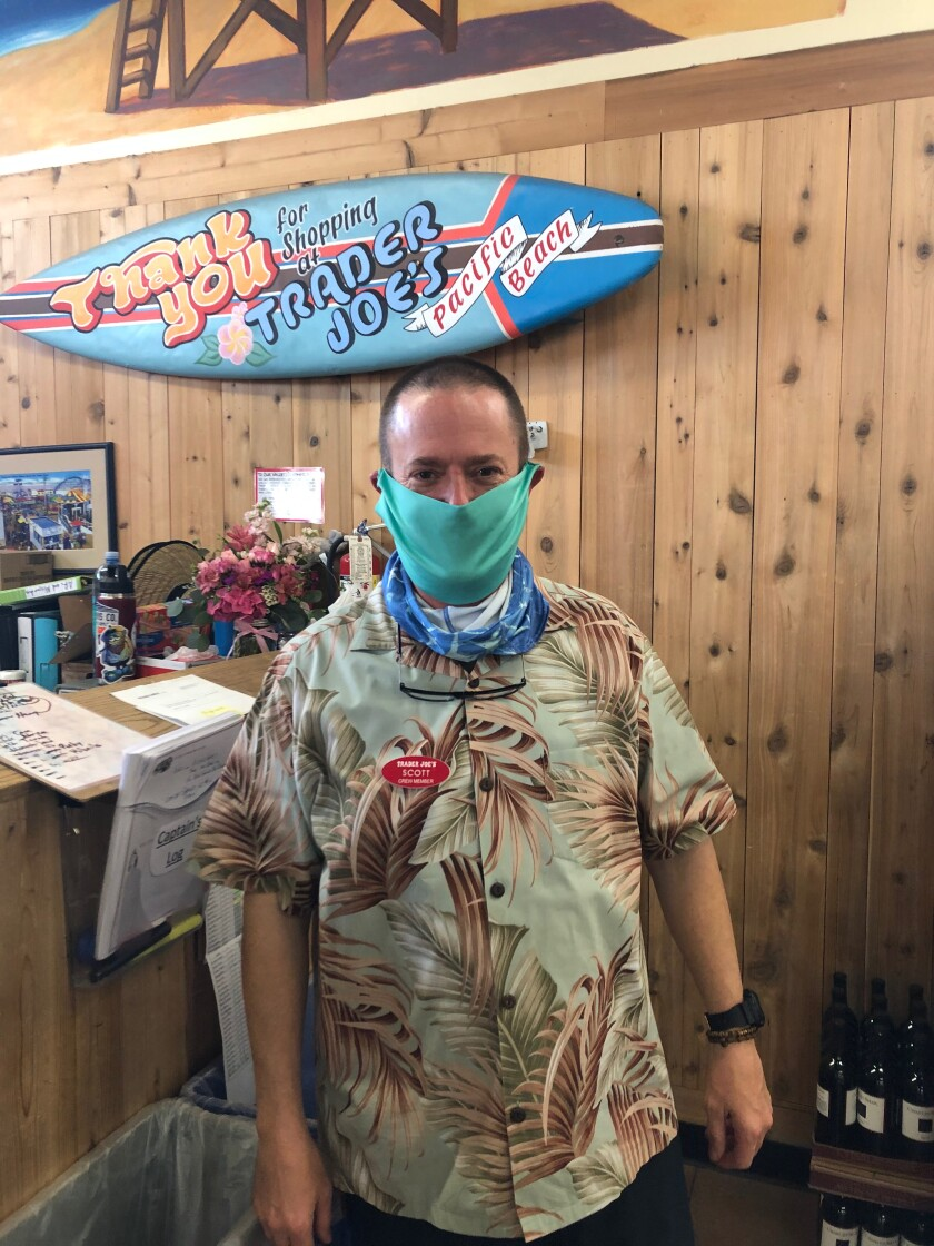 A Trader Joe's team member in Pacific Beach wears one of Scott Flavell's protective face masks.