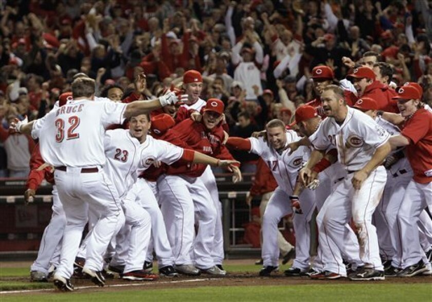 Cincinnati Reds' Jay Bruce (32) is greeted at home plate after hitting a home run off Houston Astros relief pitcher Tim Bydak in the ninth inning of a baseball game, Tuesday, Sept. 28, 2010, in Cincinnati. Cincinnati clinched the NL Central with a 3-2 win. (AP Photo/Al Behrman)