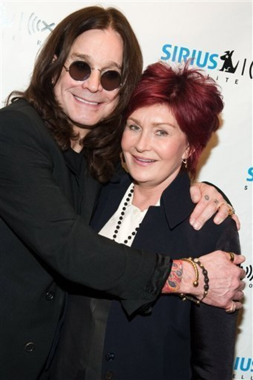 """FILE - In this May 20, 2010 file photo, Ozzy Osbourne, left, and his wife Sharon Osbourne attend a listening party for his new album """"Scream"""" at the Sirius XM studios in New York. (AP Photo/Charles Sykes, file)"""