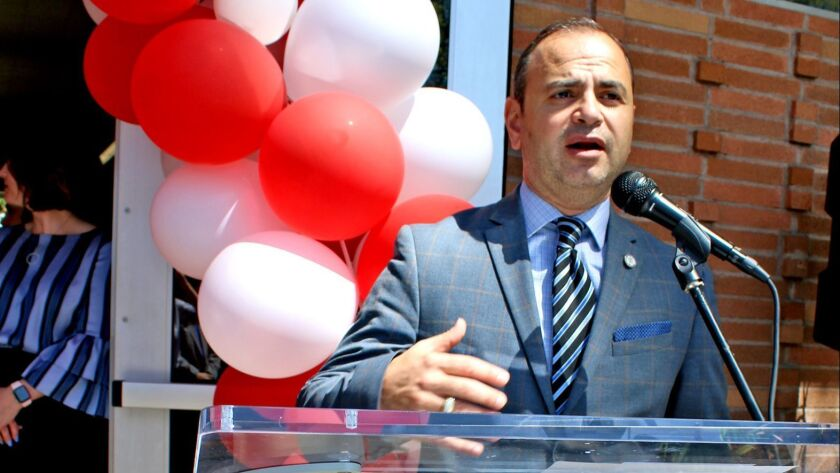 Surrounded by celebratory balloons, Glendale Mayor Zareh Sinanyan speaks at Grandview Library's re-o
