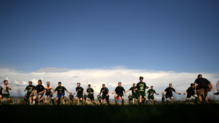 CHICO, CALIFORNIA MAY 28, 2019-Paradise High School football players run drills during practice at M