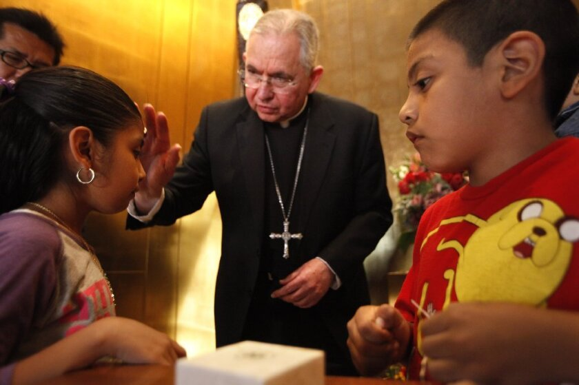Los Angeles Archbishop Jose Gomez blesses children at the chapel of Our Lady of Guadalupe inside the Cathedral of Our Lady of Angels in Los Angeles in March 2014.