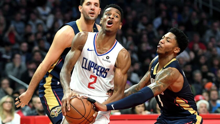 LOS ANGELES, CA. JANUARY 14, 2018-Clippers Shai Gilgeous-Alexander drives past Pelicans Nikola Mirot