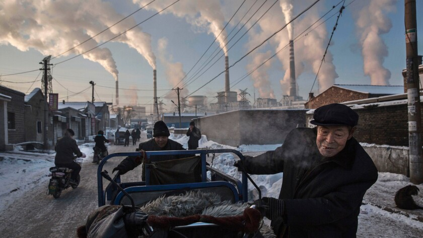 Smoke billows from factories in Shanxi, China, in 2015.