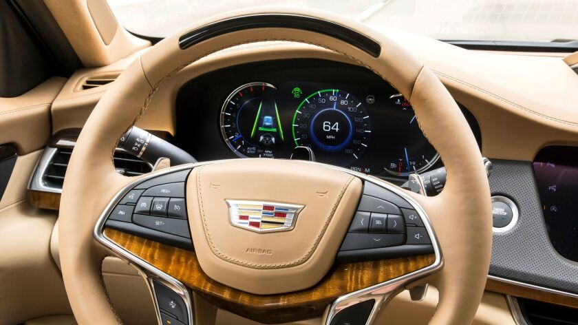 The steering wheel and dashboard icons on the CT6 outfitted with Super Cruise light up to alert the driver that the self-driving feature is available or engaged.