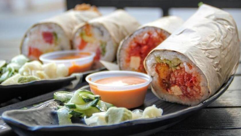 "This sushi-burrito hybrid appropriately called the ""fist bump"" hails from Sushi Freak in Downtown. (Amy T. Granite)"