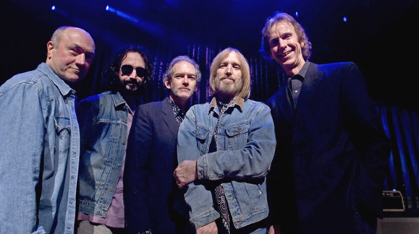 """MUDCRUTCH: Randall Marsh, left, Mike Campbell, Benmont Tench, Petty and Tom Leadon got together at Petty's behest. """"This is all about the music,"""" Petty says. """"Being in this band is so much fun."""""""