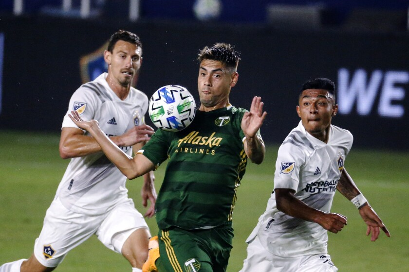 Portland Timbers forward Felipe Mora controls the ball.