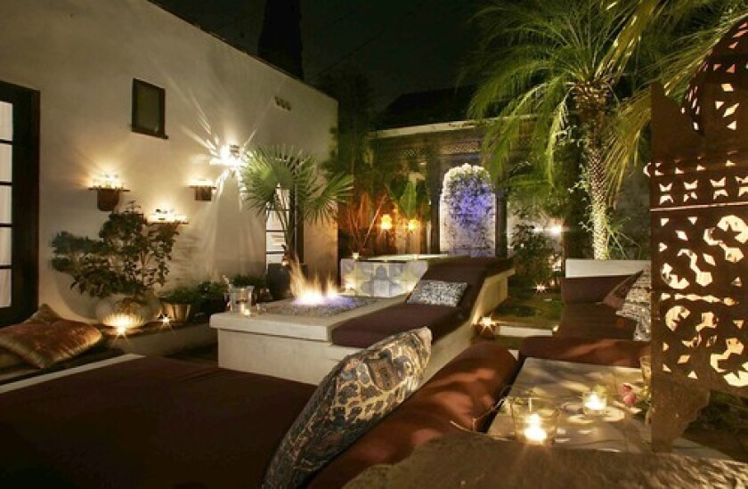 """By Debra Prinzing Mala Vasan wanted to transform her small yard in Hollywood. Tucked behind a 1924 Spanish bungalow and hemmed in by her own garage as well as her neighbor's, Vasan's yard was attractive """"only to a family of skunks that used to walk across the space,"""" she says. She turned to landscape designer Laura Morton, and in their conversations they eventually discussed a lush oasis influenced by the home's Spanish-style architecture, Mala's Indian American heritage and the two women's mutual love of travel. """"She showed me a file of imagery she'd been daydreaming about, including exotic pictures of India with elephants,"""" Morton says. In the end, the 16-by-32-foot patio was re-imagined as a two-level courtyard that feels far away from Los Angeles. """" Enclosed spaces instill a sense of intimacy,"""" Morton says, """"and within that your own sense of paradise is possible."""""""
