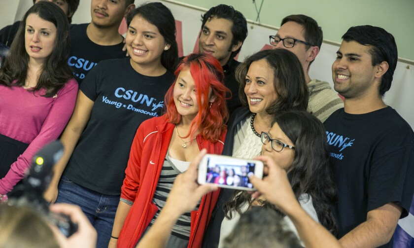Students pose for a photo with U.S. Senate candidate Kamala Harris after a campaign event at Cal State Northridge on Tuesday.