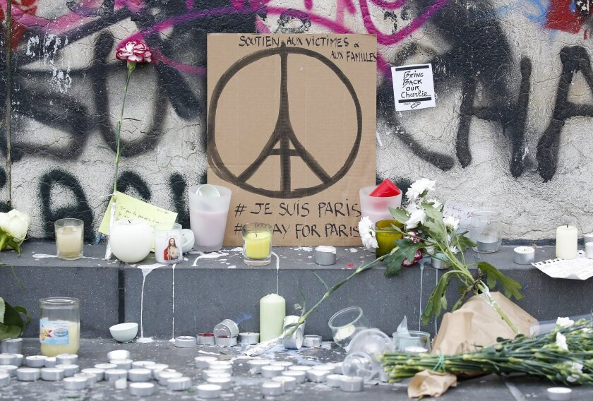 Memorials in Paris pay tribute to those killed in Friday's terror attacks.