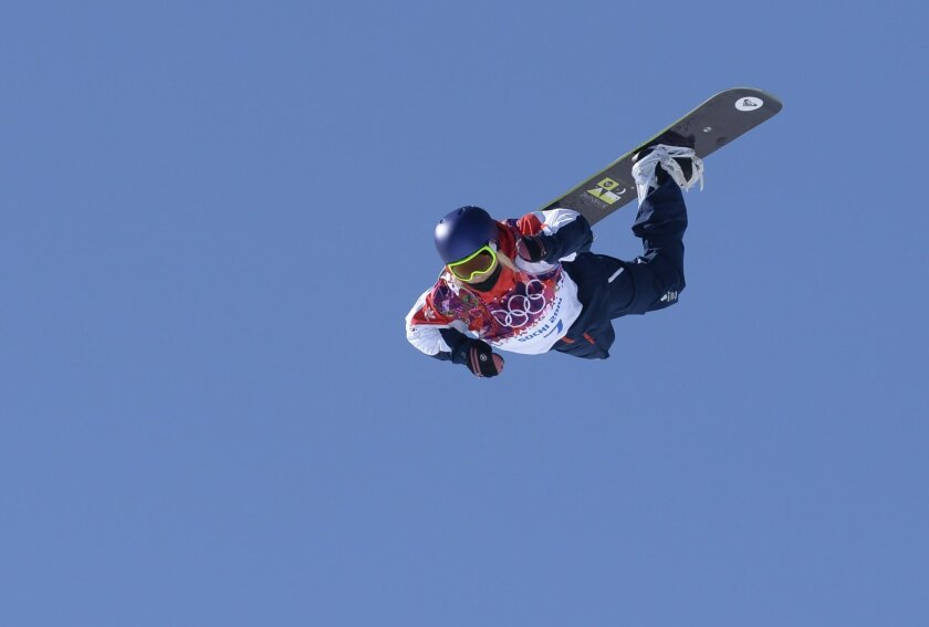 British snowboarder Aimee Fuller sails through the air at the Winter Games in Sochi, Russia.
