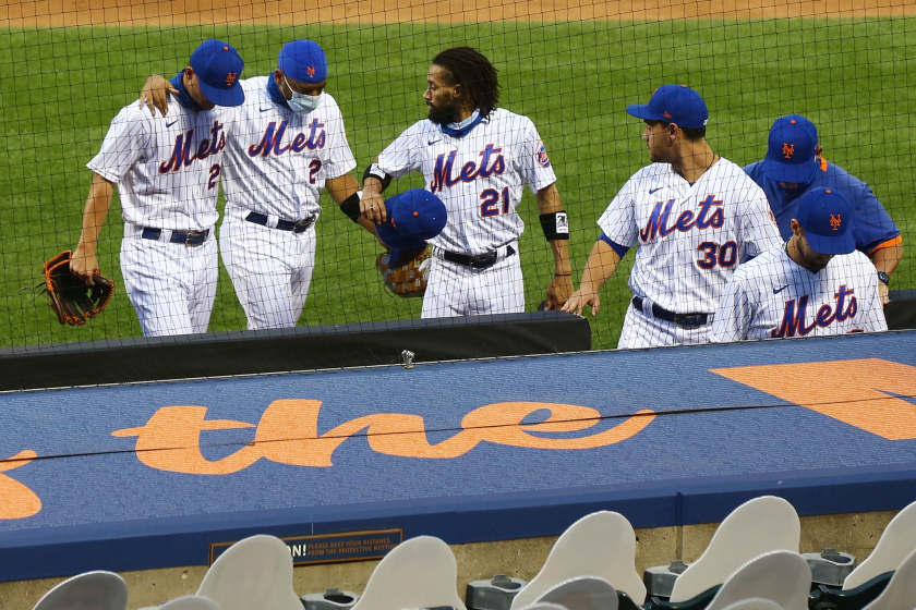 New York Mets players walk off the field after deciding not to play against the Miami Marlins on Thursday.