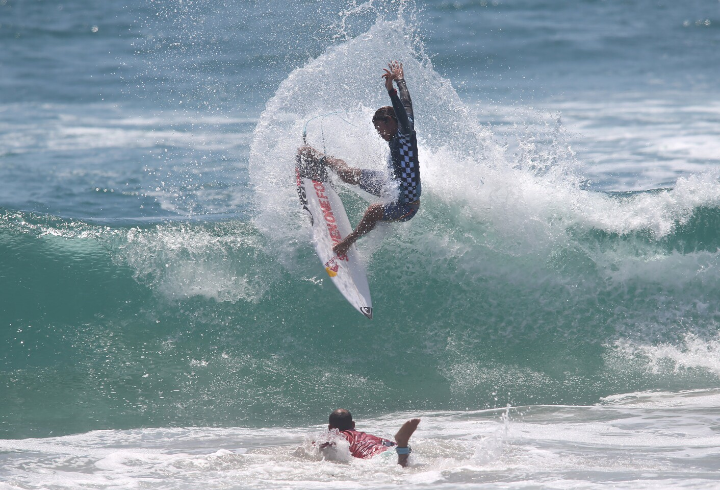 Huntington Beach's Kanoa Igarashi goes hard off the top as he surfs his way to the final against Jadson Andre during the Men's US Open semi-final on Sunday.
