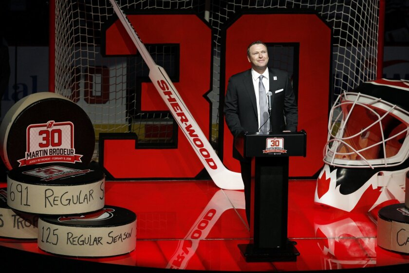Former New Jersey Devils star goalie Martin Brodeur addresses fans at the Prudential Center arena as the Devils retired Brodeur's number 30 jersey before an NHL hockey game against the Edmonton Oilers Tuesday, Feb. 9, 2016, in Newark, N.J. (AP Photo/Mel Evans)