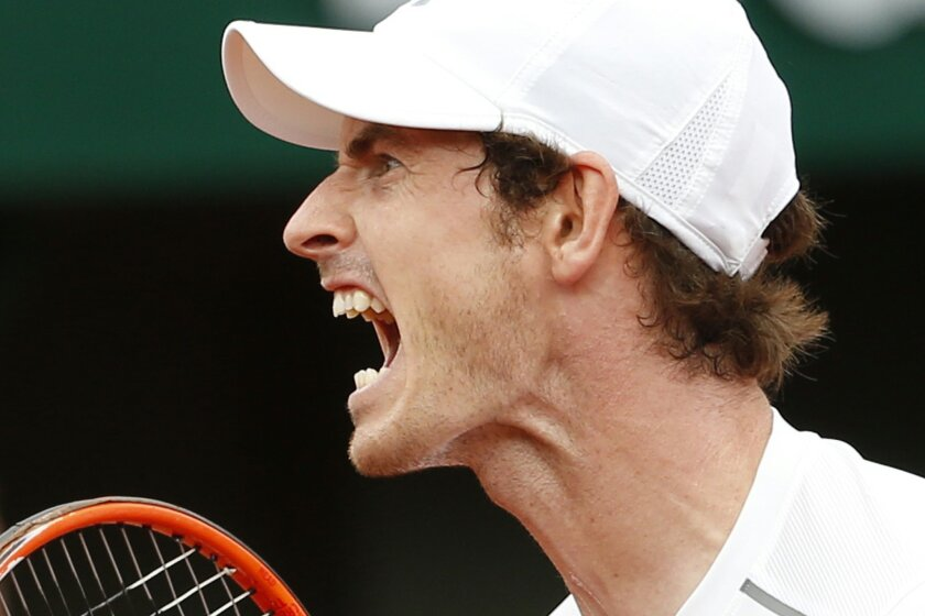 Britain's Andy Murray screams after scoring a point in his second round match of the French Open tennis tournament against France's Mathias Bourgue at the Roland Garros stadium in Paris, France, Wednesday, May 25, 2016. (AP Photo/Alastair Grant)