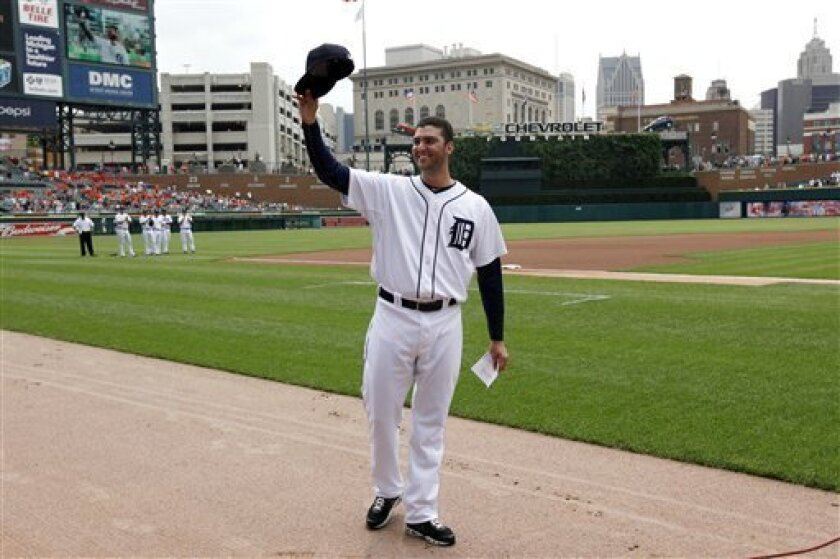 Detroit Tigers pitcher Armando Galarraga tips his hat to fans before a baseball game against he Cleveland Indians in Detroit Thursday, June 3, 2010. Galarraga lost his bid for a perfect game with two outs in the ninth inning on a disputed call at first base by umpire Jim Joyce on Wednesday night. (AP Photo/Paul Sancya)