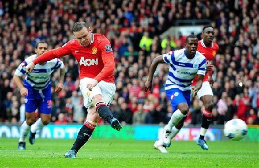 Manchester United's Wayne Rooney scores his side's first goal of the game from the penalty spot against Queen Park Rangers during the English Premier League match at Old Trafford, Manchester England Sunday April 8, 2012. (AP Photo/Owen Humphreys/PA) UNITED KINGDOM OUT NO SALES NO ARCHIVE