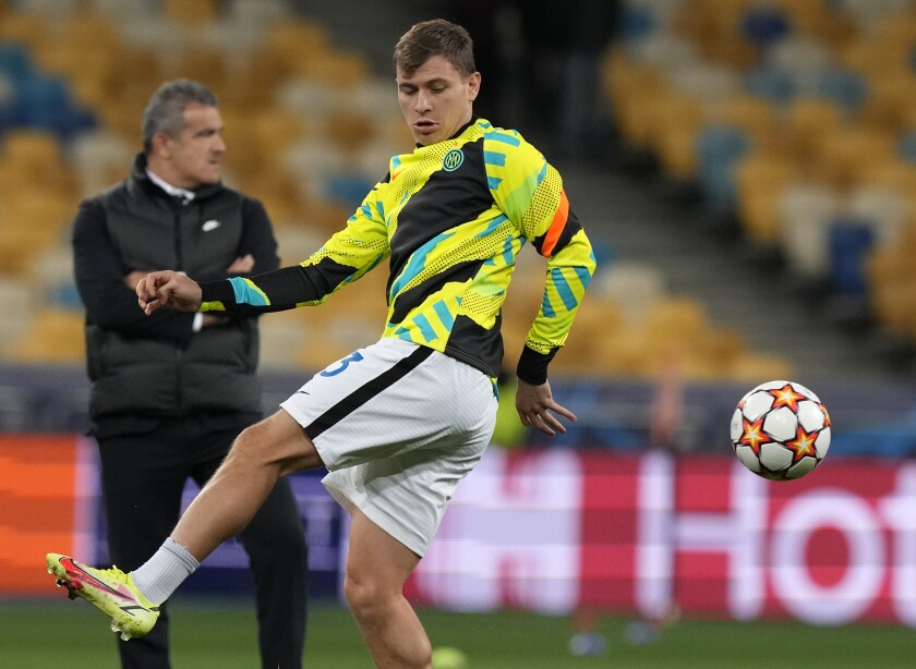 Inter Milan's Nicolo Barella warms up prior to the Champions League group D soccer match between Shakhtar Donetsk and Inter Milan at the Olimpiyskiy Stadium in Kyiv, Ukraine, Tuesday, Sept. 28, 2021. (AP Photo/Efrem Lukatsky)