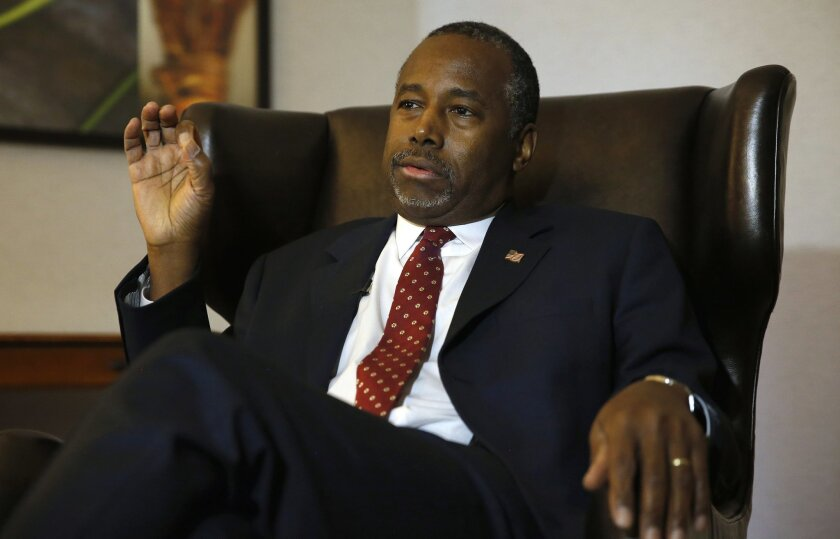 In this photo taken Oct. 28, 2015, Republican presidential candidate Ben Carson discusses faith during an exclusive interview with The Associated Press at a hotel in Broomfield, Colo. In a wide-ranging interview about his faith with The Associated Press, Ben Carson expressed pride in his little-kno