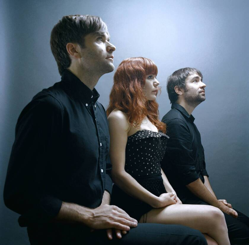 """""""Ten years later, people still want to hear us play it,"""" says Ben Gibbard, left, with Jenny Lewis and Jimmy Tamborello."""