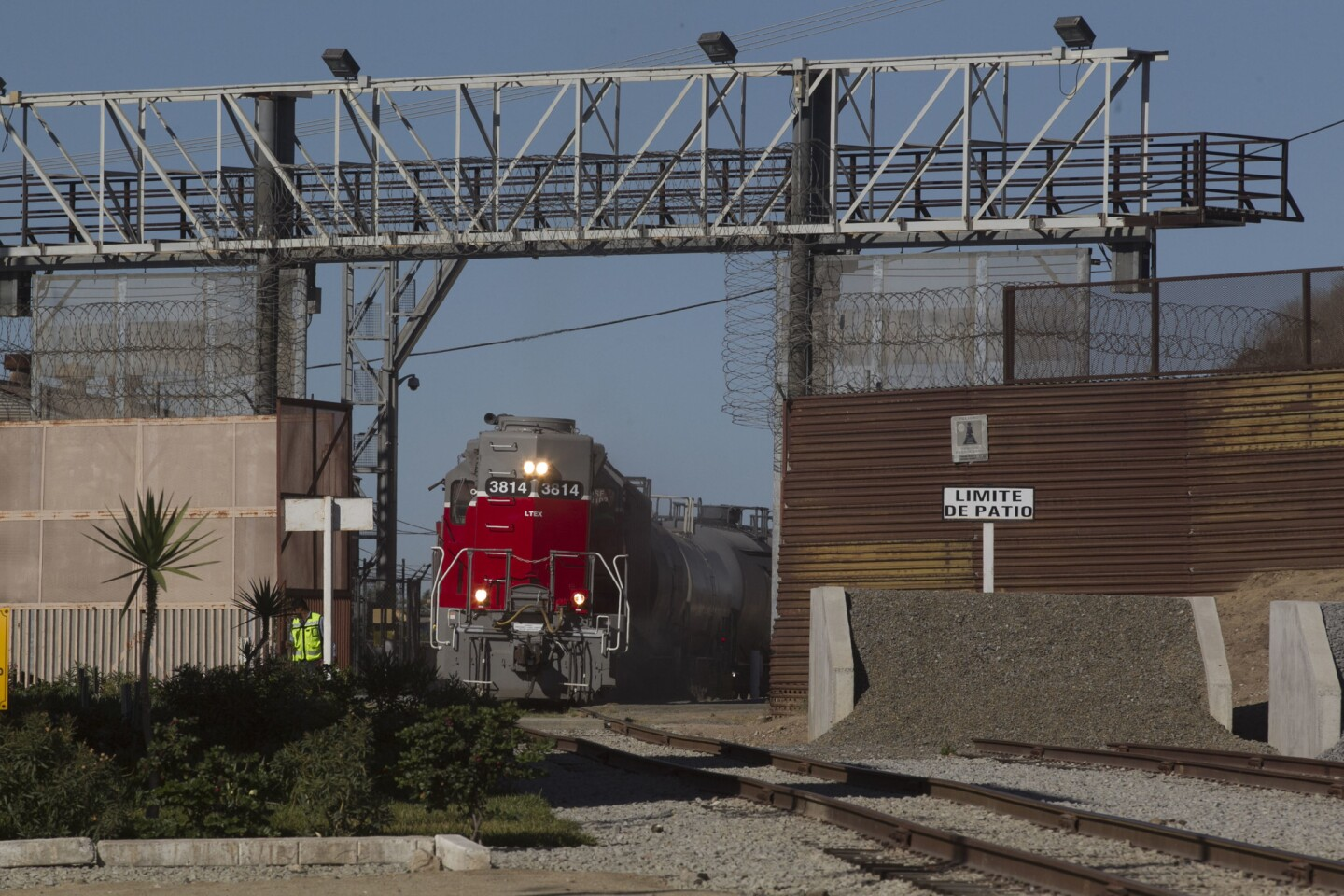 A locomotive from the Baja California Railroad heads south back in to Mexico after picking up 18 rail cars full of freight for delivery to regional clients in the Tijuana and Tecate region.