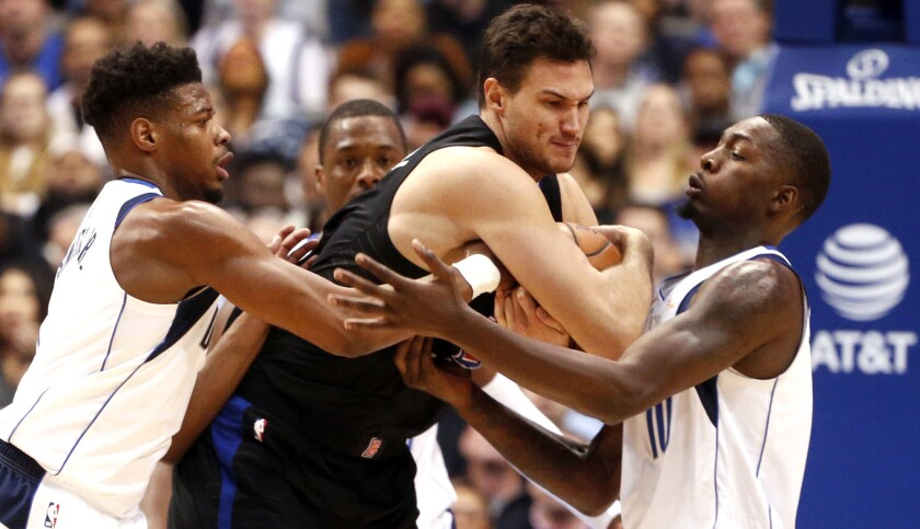 Los Angeles Clippers forward Danilo Gallinari (8) is defended by Dallas Mavericks guard Dennis Smith