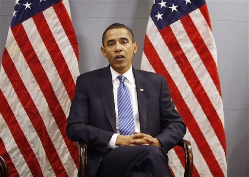 President-elect Barack Obama makes remarks, accompanied by Vice President-elect Joe Biden and Sen. Lindsey Graham, R-S.C., both not pictured, about their recent trip to Afghanistan, Iraq, Kuwait and Pakistan, Wednesday, Jan. 14, 2009, at Obama's transition office in Washington. (AP Photo/Gerald Her