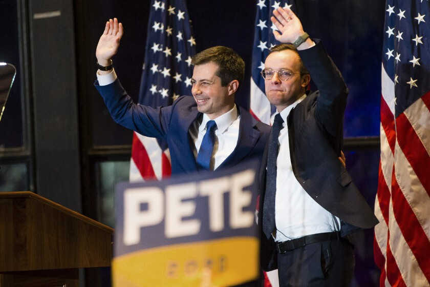 In this March 1, 2020 photo, former South Bend Mayor Pete Buttigieg and his husband Chasten Buttigieg, respond to audience members after an announcement of Pete Buttigieg's ending the campaign for president, in South Bend, Ind. Buttigieg's presidential candidacy, though ending far short of its goal, will likely go down in history books as a success: proof of the remarkable advances made by LGBT Americans in their quest for equality and acceptance. (Michael Caterina/South Bend Tribune via AP)