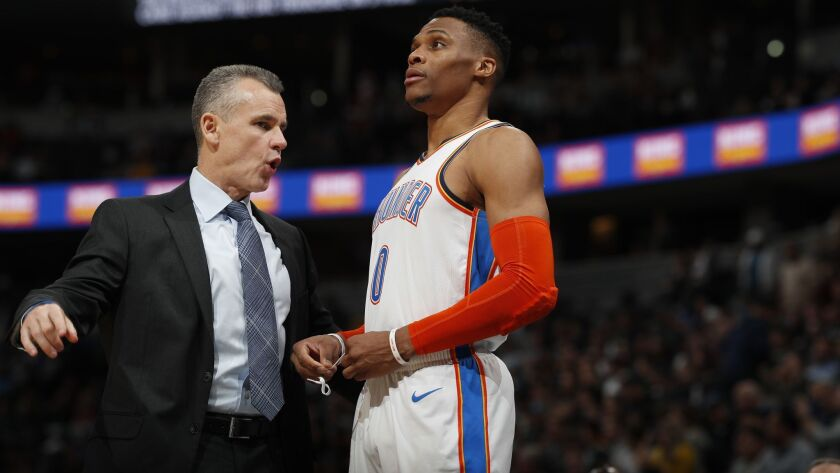Oklahoma City Thunder head coach Billy Donovan and Oklahoma City Thunder guard Russell Westbrook (0) in the second half against the Nuggets on Dec. 14, 2018, in Denver.