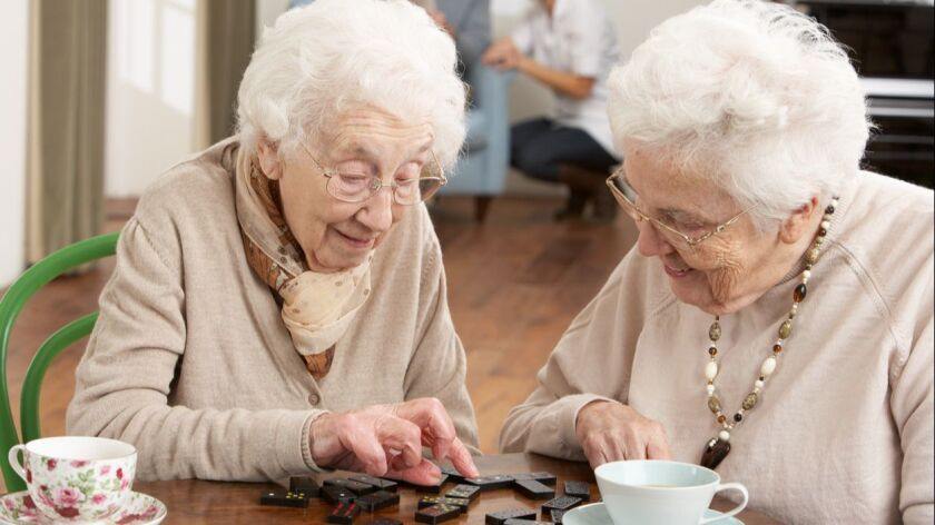 Senior women playing dominoes at a daycare center