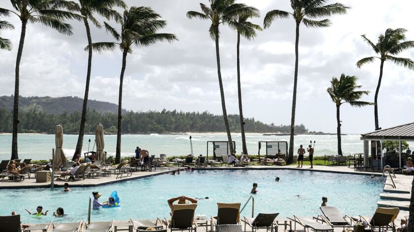 KAHUKU, HI - AUGUST 21: People lounge at the Pool area at the Turtle Bay Resorts's The Point Sunset