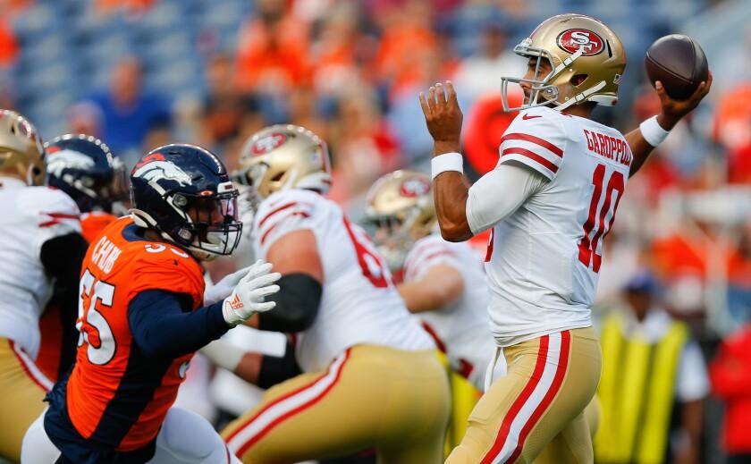 San Francisco 49ers quarterback Jimmy Garoppolo prepares to throw an interception under pressure from Broncos linebacker Bradley Chubb during a preseason game Monday in Denver.