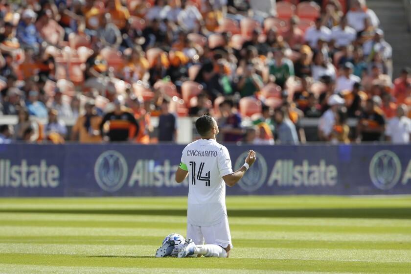 "Galaxy forward Javier ""Chicharito"" Hernandez prays on the field before the team's season opener against the Houston Dynamo on Feb. 29."