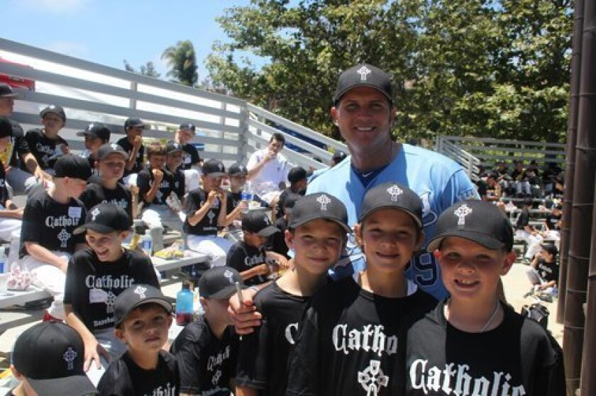 Mike Sweeney with some of his campers at the recent Catholic Baseball Camp.