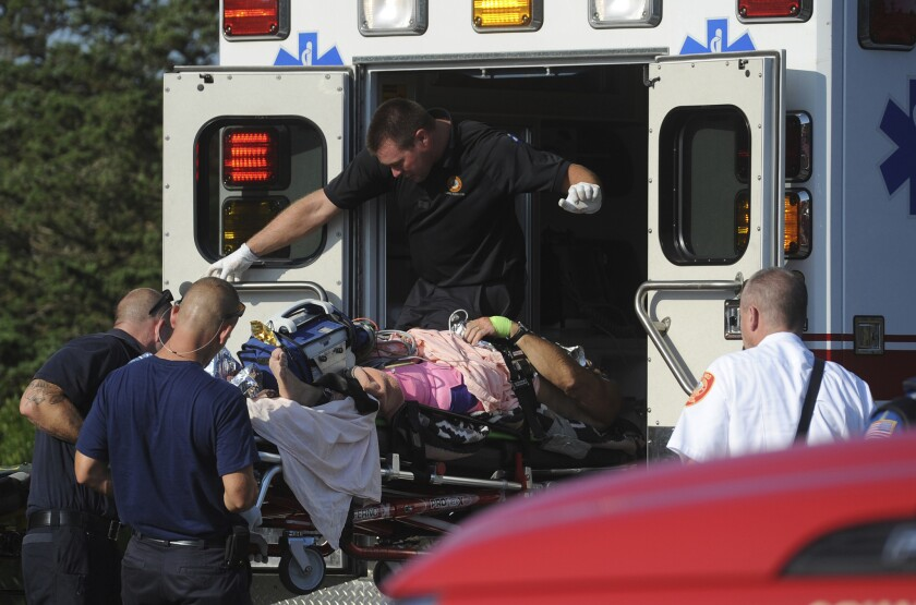 A man is transferred from an ambulance to a helicopter after being attacked by a shark on Aug. 15, 2018 in South Wellfleet, Mass.