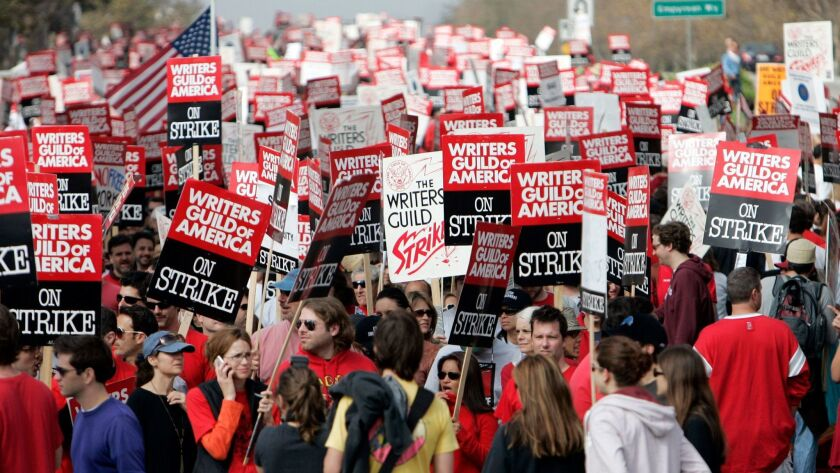 Thousands of Writers Guild of America (WGA) writers and others march down Avenue Of The Stars in the