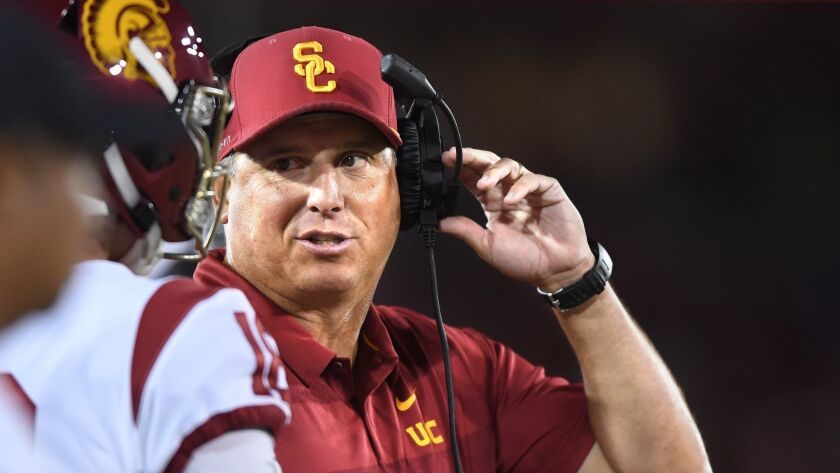 USC coach Clay Helton speaks to one of his players during a game against Stanford in September.
