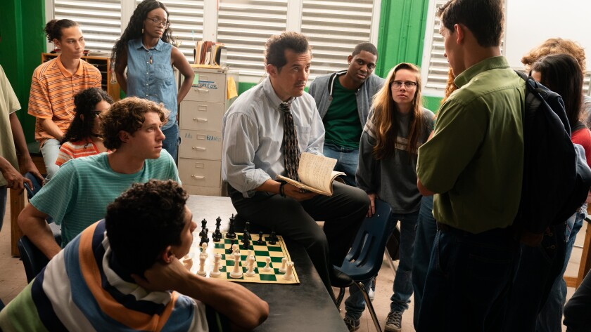 "John Leguizamo, center, in a scene from the Starz autobiographical drama ""Critical Thinking"""