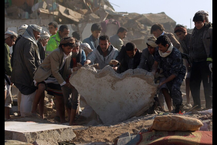 Yemeni civilians and security forces search for survivors in the rubble of buildings destroyed during Saudi airstrikes near Sana Airport on March 26.