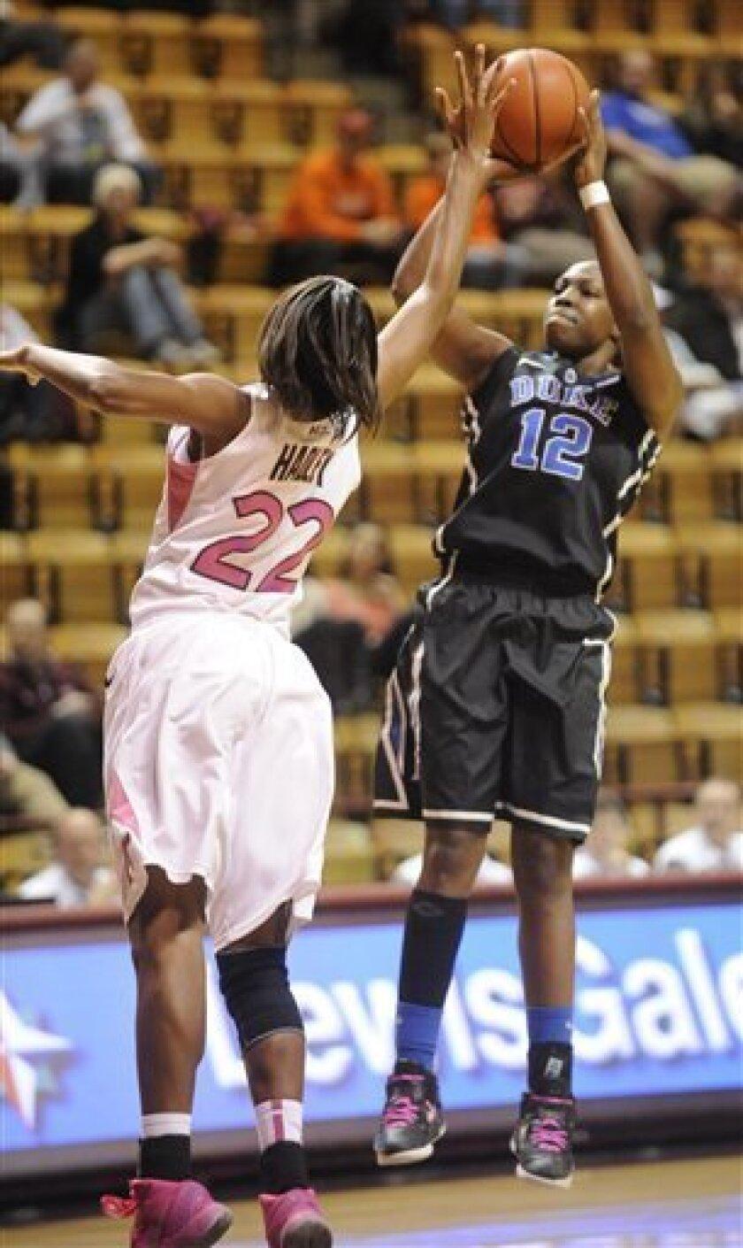 Duke's Chelsea Gray (12) shoots over Virginia Tech's Porschia Hadley (22) during the first half of an NCAA college basketball game Thursday, Feb. 14, 2013, at Cassell Coliseum in Blacksburg, Va. (AP Photo/Don Petersen)